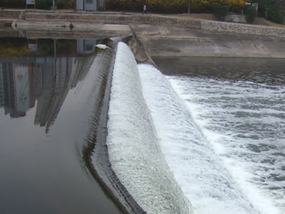 rapid water is flowing on the inflatable rubber dam