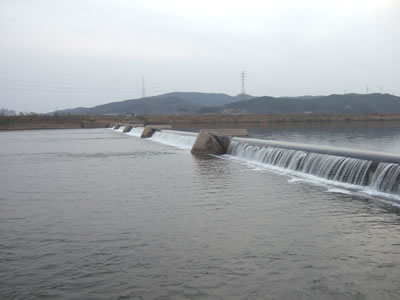 long rubber dam is stretching across the river